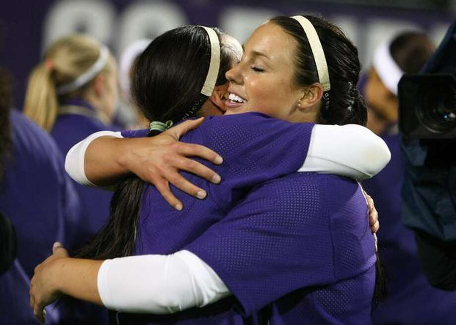 University of Washington pitcher Danielle Lawrie embraces teammate Jenn Salling after the UW defeated the University of Oklahoma in the third in a series of games in the NCAA Super Regionals on Friday May 28, 2010 at Husky Stadium. The win advances the Huskies to the championship round. Photo: Joshua Trujillo, Seattlepi.com