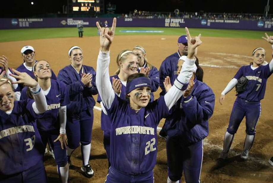 University of Washington players, including Alyson McWherter, celebrate after defeating the University of Oklahoma during the third in a series of games in the NCAA Super Regionals on Friday May 28, 2010 at Husky Stadium. Photo: Joshua Trujillo, Seattlepi.com