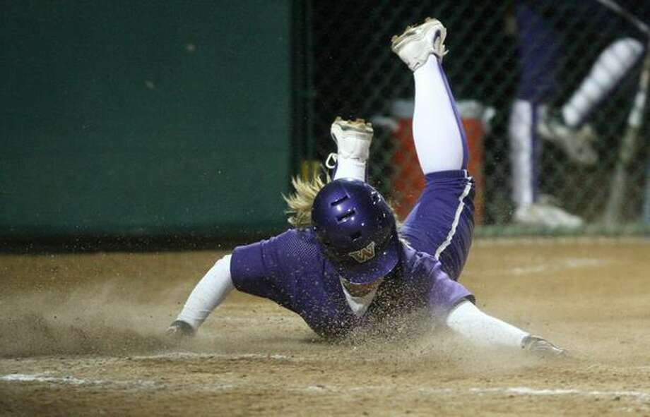 University of Washington player Amanda Fitzsimmons slides safely into home to score a run against the University of Oklahoma during the third in a series of games in the NCAA Super Regionals on Friday May 28, 2010 at Husky Stadium. Photo: Joshua Trujillo, Seattlepi.com