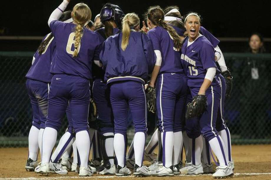 University of Washington players celebrate after completing an inning against the University of Oklahoma during the third in a series of games in the NCAA Super Regionals on Friday May 28, 2010 at Husky Stadium. The Huskies defeated the Sooners 3-0. Photo: Joshua Trujillo, Seattlepi.com