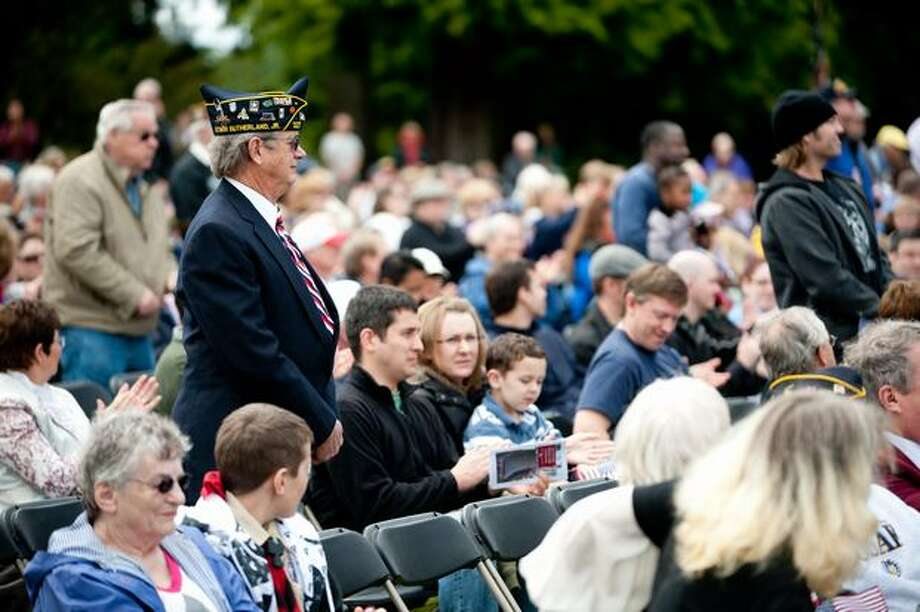 Veterans rise to applause as their song is played during a Memorial Day service in Seattle. Photo: Elliot Suhr, Seattlepi.com
