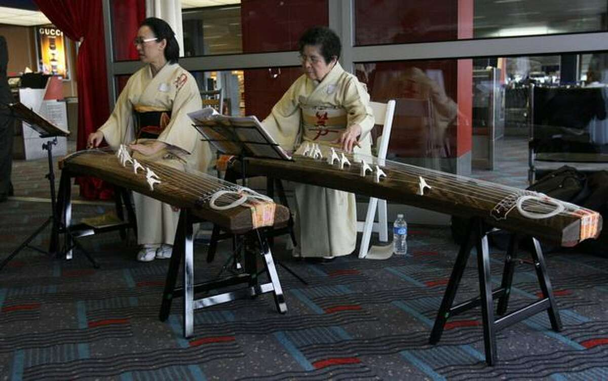 Musicians perform during a ceremony at SeaTac Airport marking the start of Delta Air Lines' nonstop flights between Seattle and Osaka, Japan.