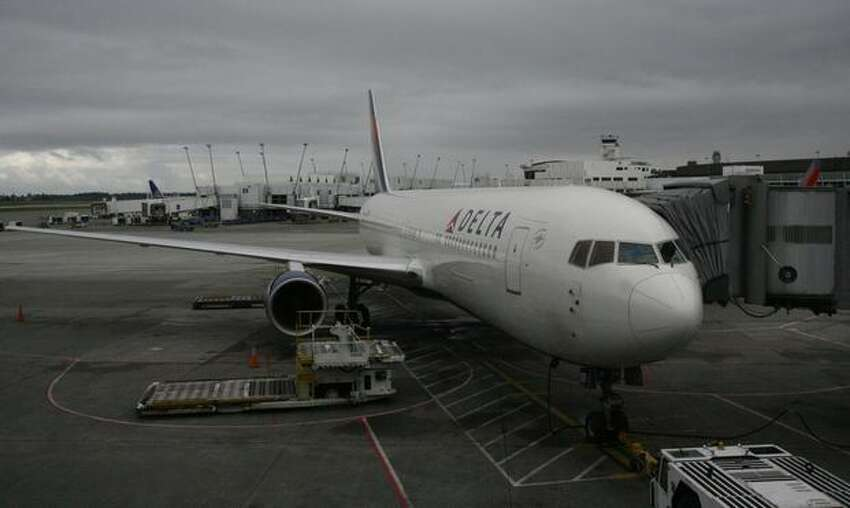 A Delta Air Lines Boeing 767-300ER waits at the gate at SeaTac Airport for carrier's first scheduled nonstop flight from Seattle to Osaka, Japan.