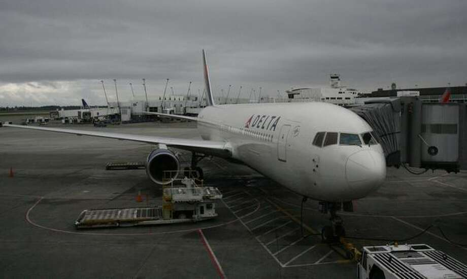 A Delta Air Lines Boeing 767-300ER waits at the gate at SeaTac Airport for carrier's first scheduled nonstop flight from Seattle to Osaka, Japan in 2010. Photo: Aubrey Cohen, Seattlepi.com