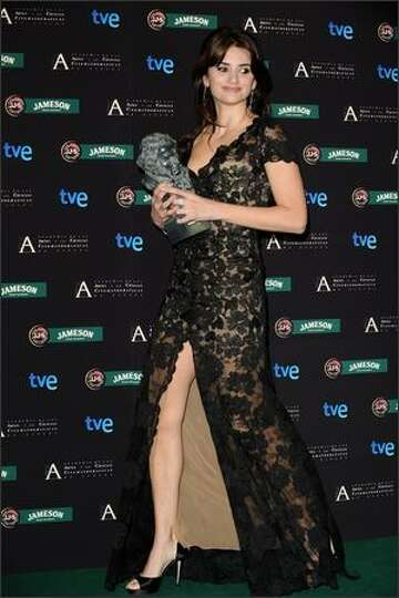 Actress Penelope Cruz poses after receiving the best supporting actress award during the Goya Cinema