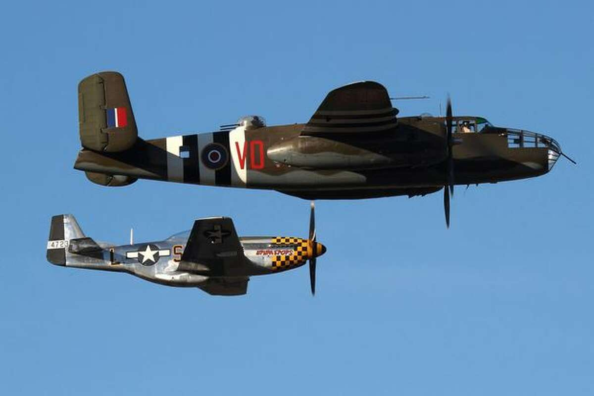A Mitchell B-25D bomber from Everett's Historic Flight Restoration Center and a P-51 Mustang from Everett's Flying Heritage Collection fly at Boeing Field, in Seattle. (Jeremy Lindgren/NYCAviation.com)