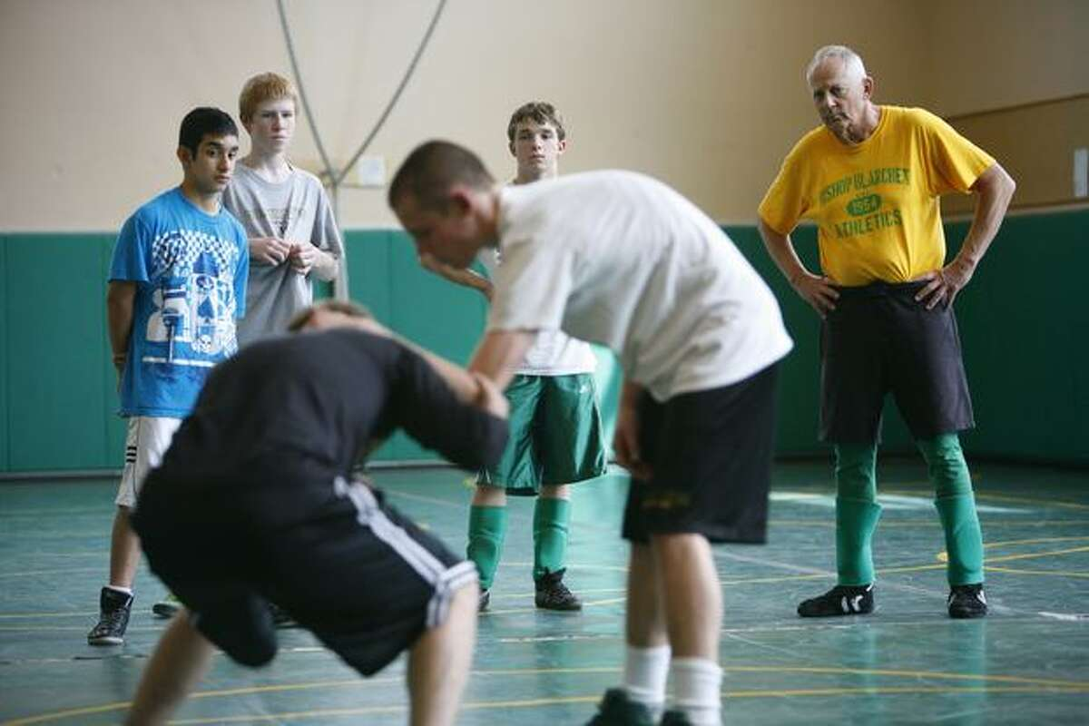 Long-time Bishop Blanchet coach and teacher Bill Herber works with students during a wrestling camp on June 2, 2010 at the school in north Seattle. Herber has been a coach, teacher and friend to generations of students that have attended Blanchet. He retired this year after 50 years teaching at the Catholic school.