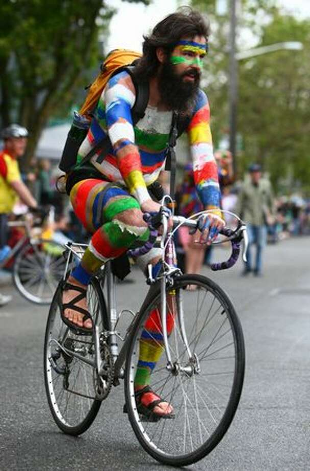 A painted cyclist rides the route during the Fremont Solstice Parade on Saturday June 19, 2010 in Seattle. Photo: Joshua Trujillo, Seattlepi.com