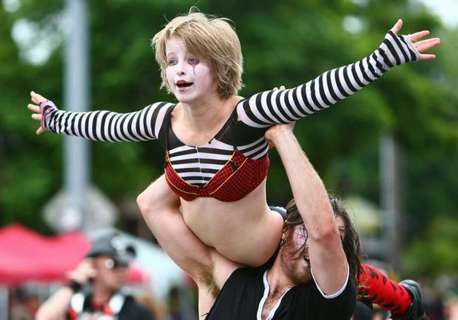 A circus performer is hoisted in the air during the Fremont Solstice Parade on Saturday June 19, 2010 in Seattle. Photo: Joshua Trujillo, Seattlepi.com