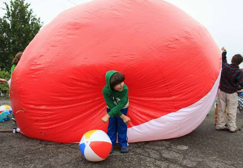 Gavin Eachus helps prepare a giant beach ball before the Fremont Solstice Parade on Saturday June 19, 2010 in Seattle. Photo: Joshua Trujillo, Seattlepi.com