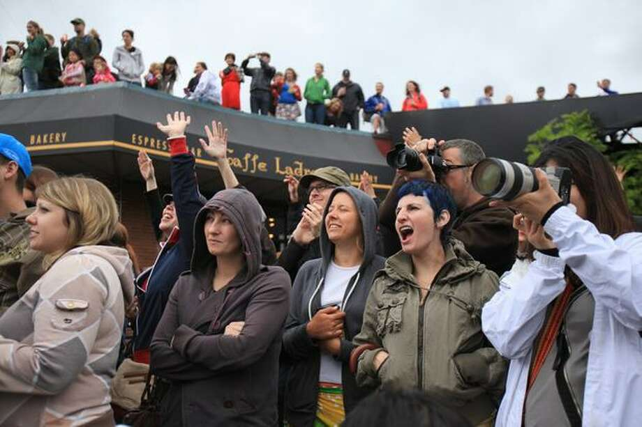 Camera and cheers greet the beginning of the the Fremont Solstice Parade on Saturday June 19, 2010 in Seattle. Photo: Joshua Trujillo, Seattlepi.com