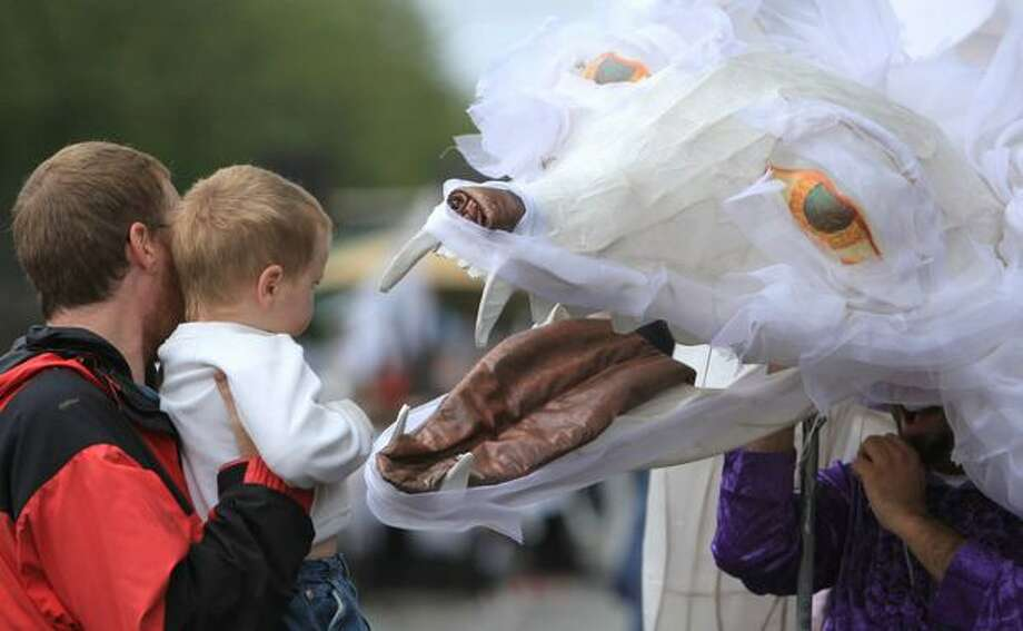 A wolf costume greets a young fan during the Fremont Solstice Parade on Saturday June 19, 2010 in Seattle. Photo: Joshua Trujillo, Seattlepi.com