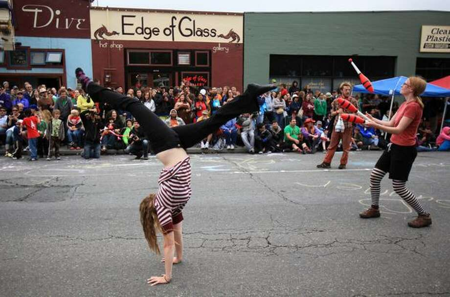 Circus performers make their way along North 36th Street in Fremont during the Fremont Solstice Parade on Saturday June 19, 2010 in Seattle. Photo: Joshua Trujillo, Seattlepi.com
