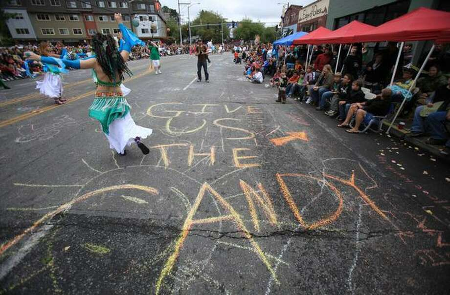 Chalk directs parade participants where to toss candy during the Fremont Solstice Parade on Saturday June 19, 2010 in Seattle. Photo: Joshua Trujillo, Seattlepi.com