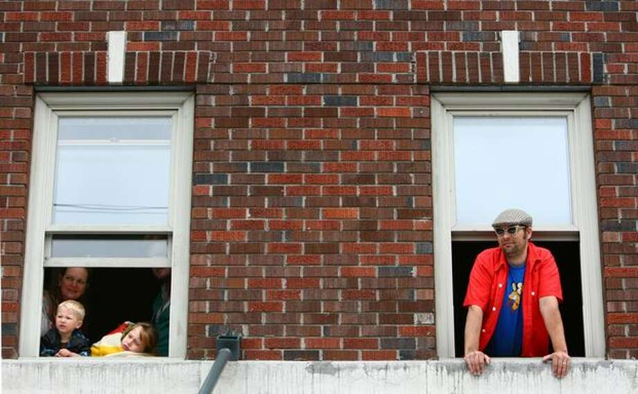 People watch the parade from overhead during the Fremont Solstice Parade on Saturday June 19, 2010 in Seattle. Photo: Joshua Trujillo, Seattlepi.com