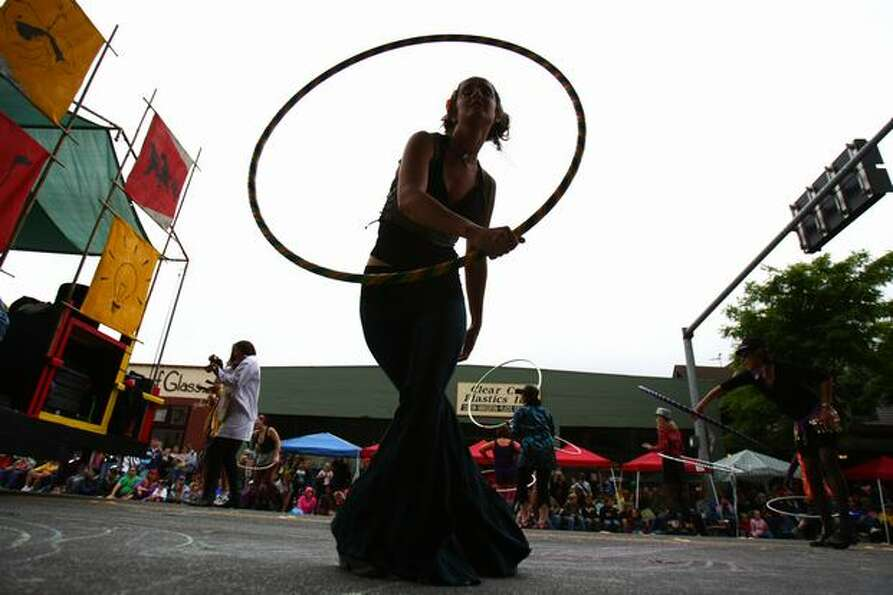 A performer twirls a Hula Hoop during the Fremont Solstice Parade on Saturday June 19, 2010 in Seatt