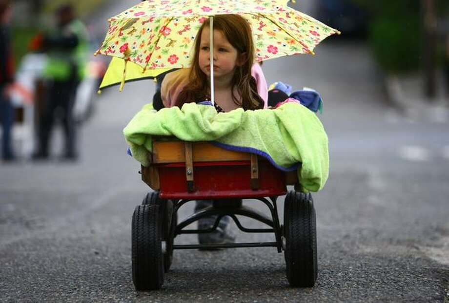 Nadine Harpster, 4, tries to stay dry during a light drizzle before the Fremont Solstice Parade on Saturday June 19, 2010 in Seattle. Photo: Joshua Trujillo, Seattlepi.com