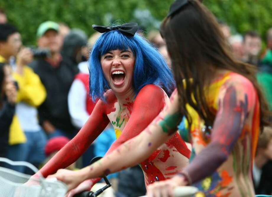 Painted cyclists ride the route during the Fremont Solstice Parade on Saturday June 19, 2010 in Seattle. Photo: Joshua Trujillo, Seattlepi.com