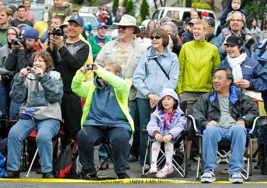 Spectators of the 22nd Annual Fremont Solstice Parade watch nude bicyclists ride by on North 36th Street on Saturday June 19, 2010. Photo: Sang Cho, Seattlepi.com