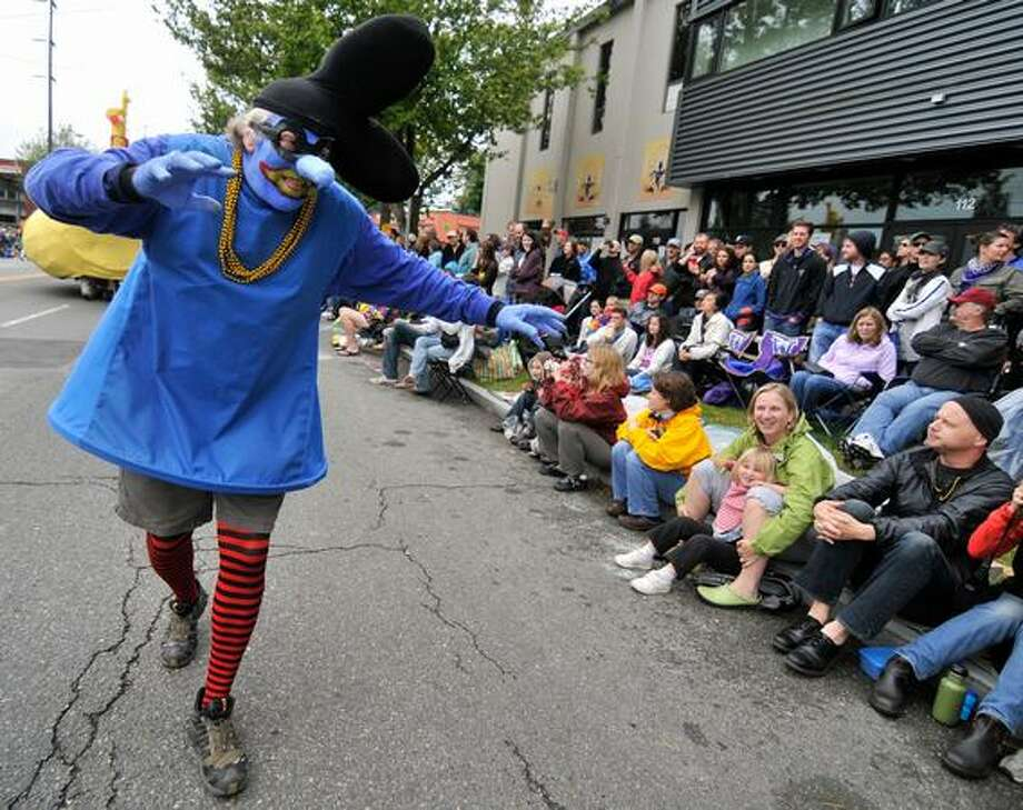 Blue Meanie Eddie Griffiths tries to scare the spectators of the Fremont Solstice Parade on Saturday June 19, 2010. Photo: Sang Cho, Seattlepi.com