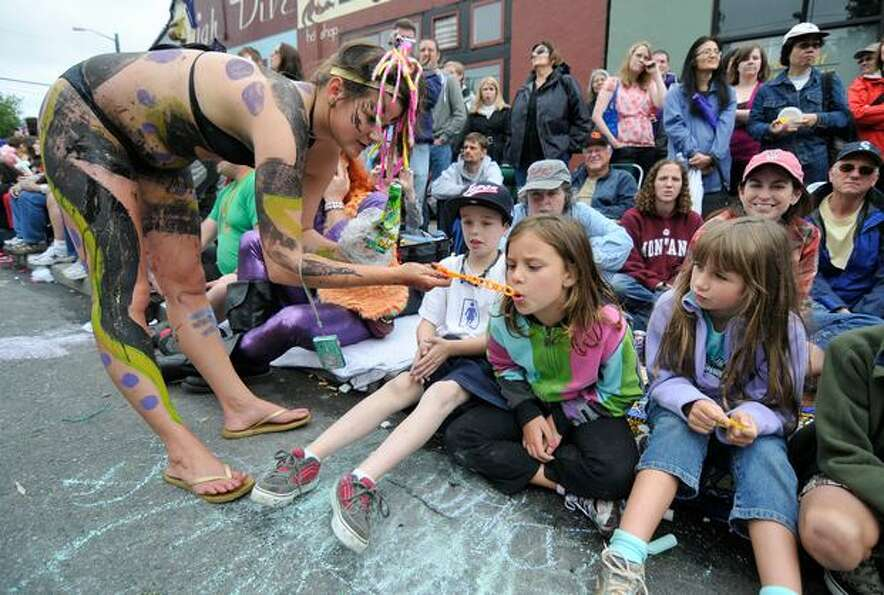 Becky Rottenstin lets spectators blow soap bubbles during the Fremont Solstice Parade on Saturday Ju