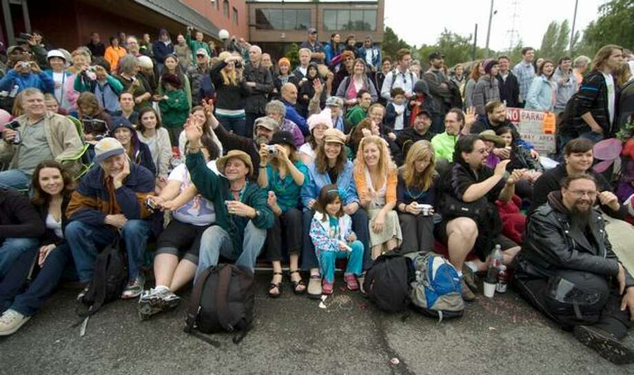 Spectators cheer as the 22nd Annual Fremont Solstice Parade commences on Saturday June 19, 2010. Photo: Sang Cho, Seattlepi.com