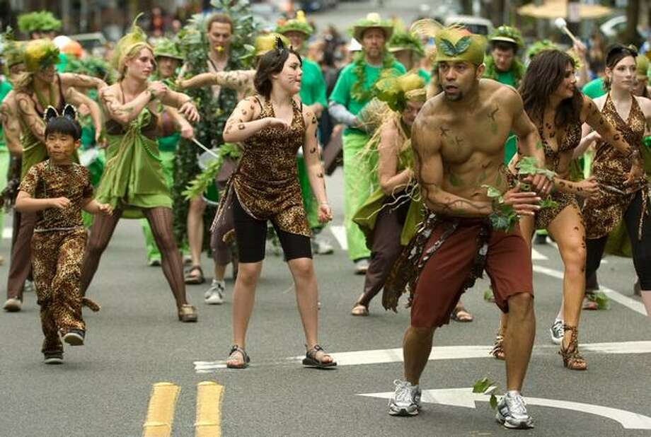 Dancers from VamoLa stomp through Fremont Ave North on Saturday June 19, 2010. Photo: Sang Cho, Seattlepi.com