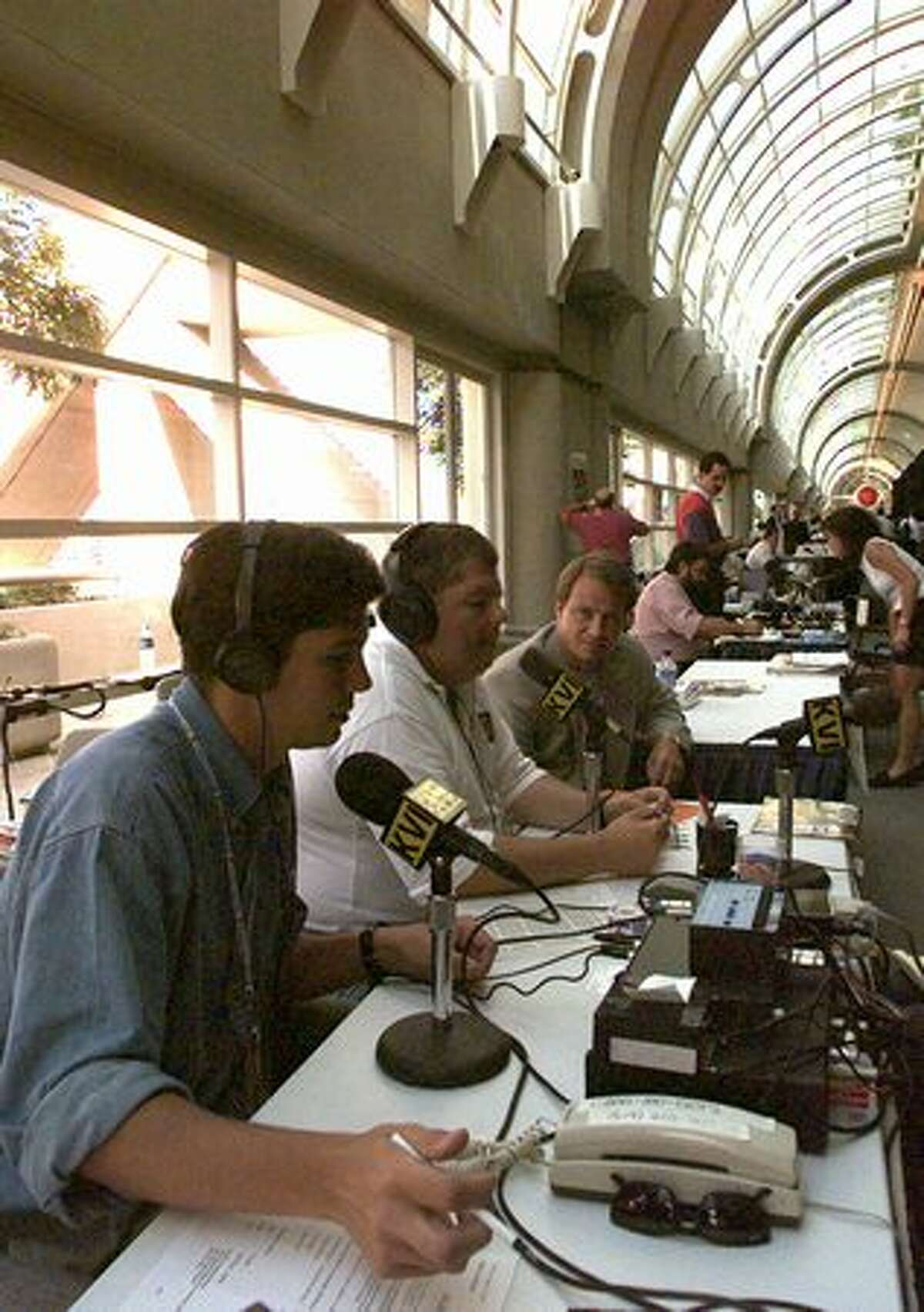 KVI radio's G. Schroeder, left, Kirby Wilbur, center, and Rob Strauss do their program from the second floor of the San Diego Convention Center, Aug. 13, 1996. (V. Arocho/seattlepi.com file)
