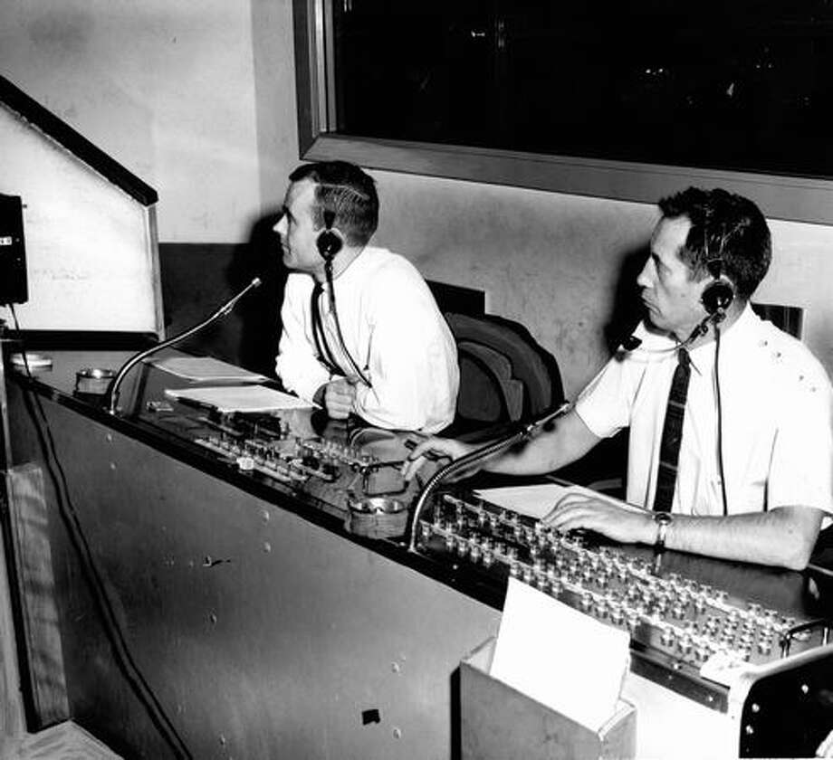 Ken Schwedop, left, and Allan G. Miller, technical director, monitor a program from a KING control room, January 1964. Photo: P-I File