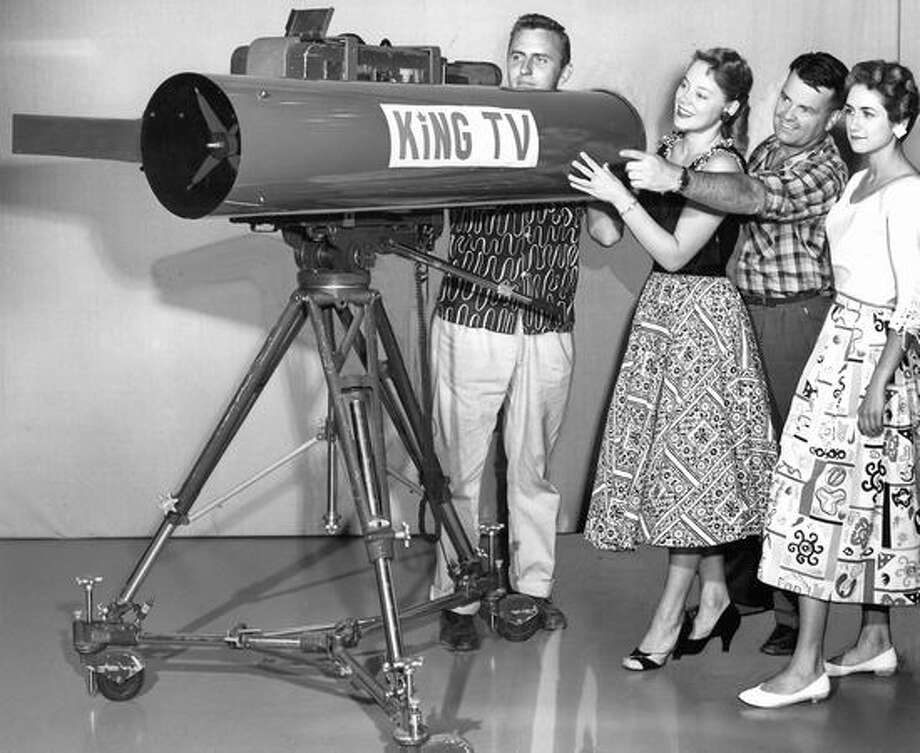 Al Smith, Bonnie Stoa, Earl Thoms and Nola Martin are pictured inspecting a 100-inch telelens KING-TV used on closeups of the Seafair Trophy Race in August 1956. Photo: P-I File