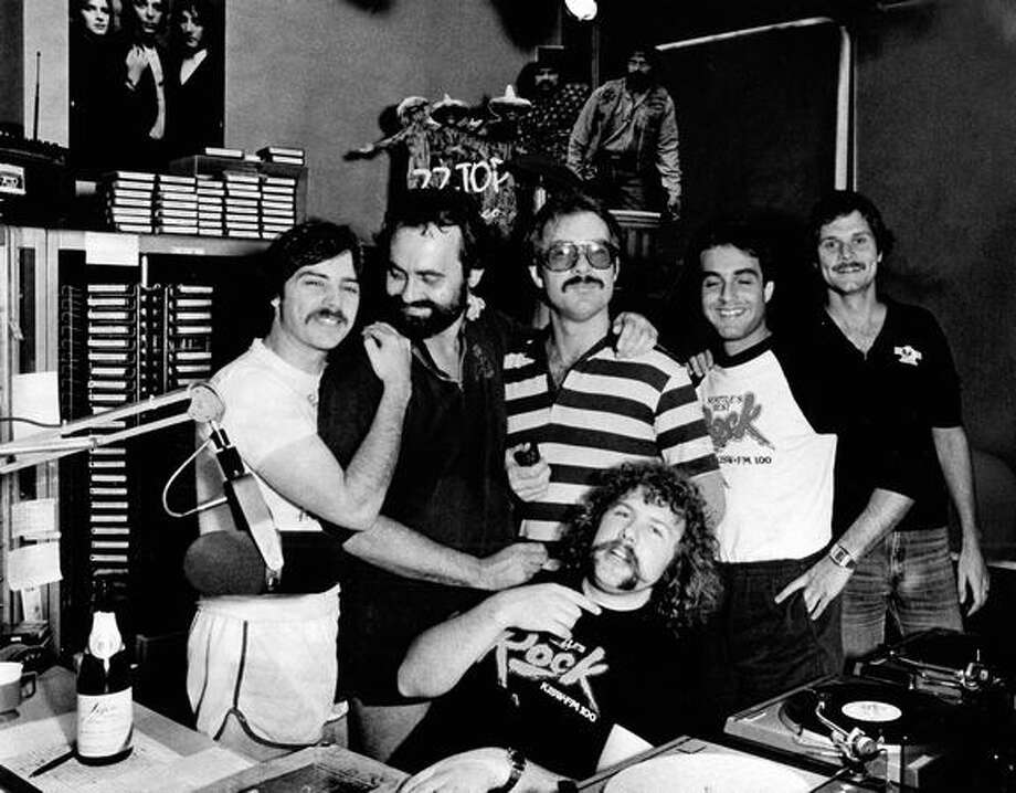 KISW DJs celebrate their No. 1 rating, July 1981. Larry Sharp is in front. The back row is, from left, Bob Havanes, Gary Crow, John Langan, Mike West and Dr. Rock. (Gilbert Arias/Seattlepi.com file) Photo: P-I File