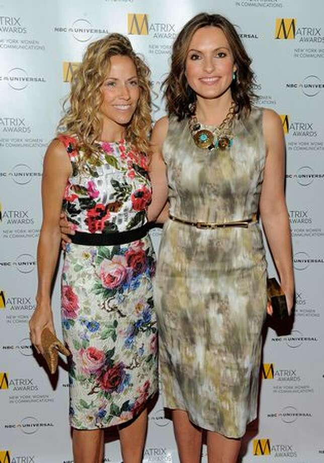 Singer Sheryl Crow and actress Mariska Hargitay pose for photos at the 2010 Matrix Awards presented by New York Women in Communications at The Waldorf Astoria in New York City. Photo: Getty Images