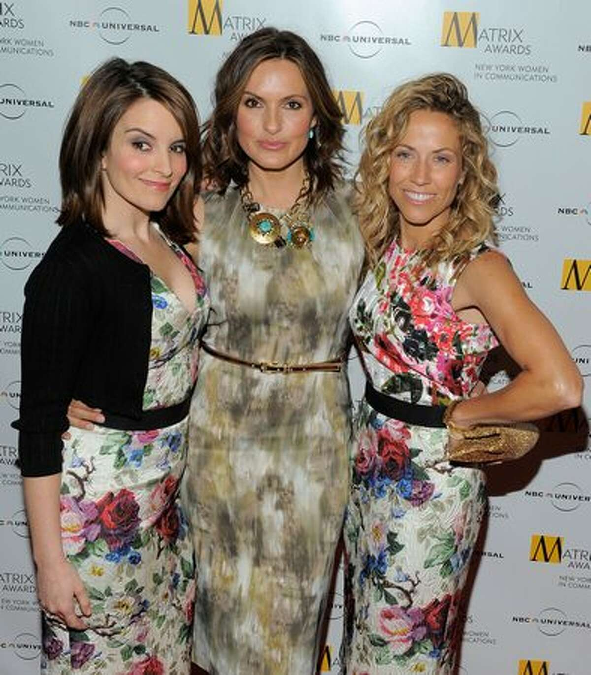 Comedian Tina Fey, actress Mariska Hargitay and singer Sheryl Crow pose for photos at the 2010 Matrix Awards presented by New York Women in Communications at The Waldorf Astoria in New York City.