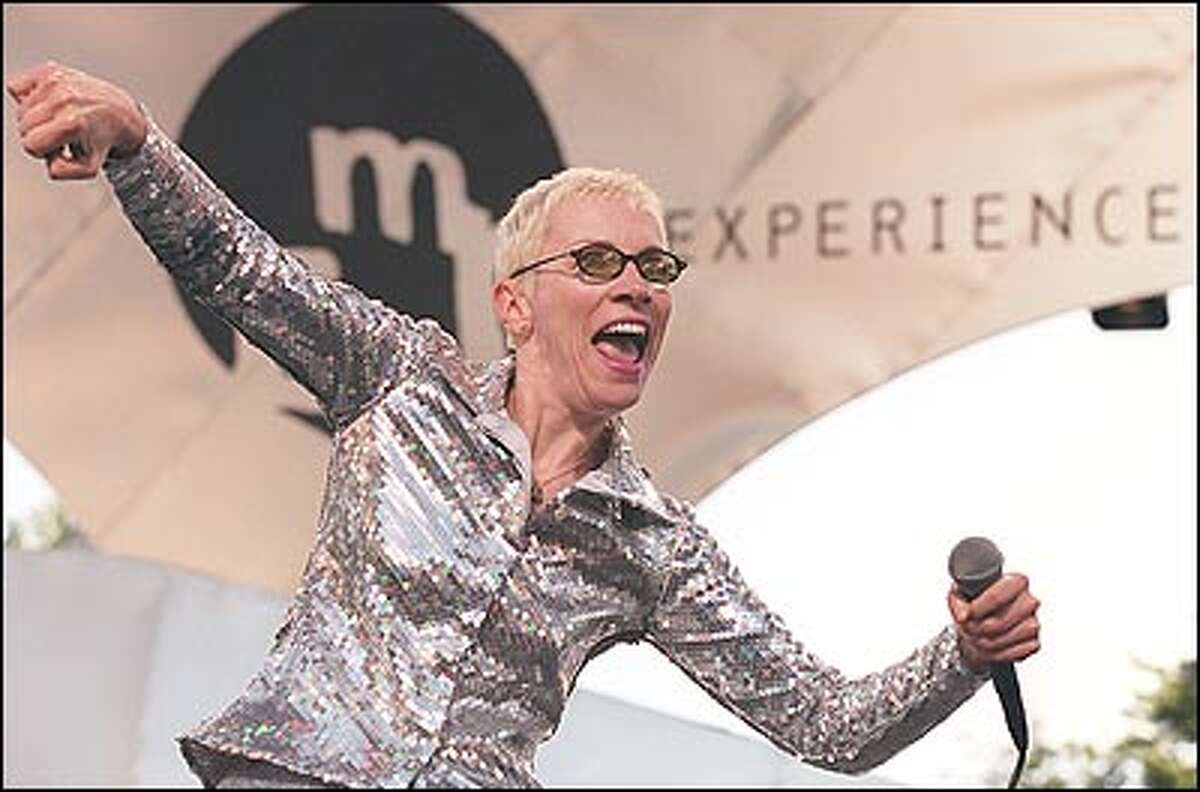 The Eurythmics' Annie Lennox performs at Memorial Stadium during Saturday night's EMP concert. The band walked offstage briefly because of a noisy helicopter.