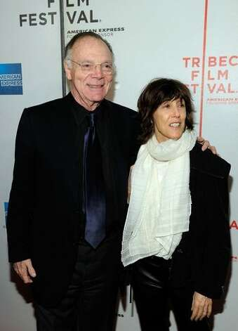 "Writer Nora Ephron and her husband Nicholas Pileggi attend a premier.  She wrote Roman a clef, ""Heartburn,"" about infidelities of previous spouse Carl Bernstein, at a time when she was gaining fame for screenplays while he was gaining noteriety as a party animal. Photo: Getty Images"