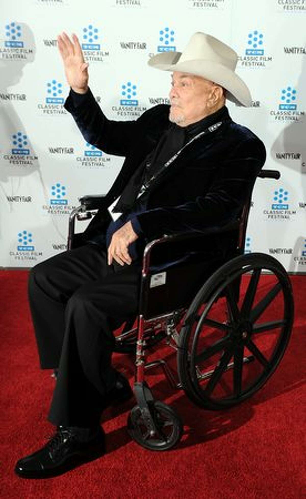"""Actor Tony Curtis arrives at the world premiere of the restored """"A Star is Born"""" during the opening Night Gala of the 2010 TCM Classic Film Festival in Hollywood, California, on April 22, 2010."""