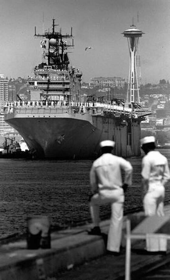 Seaman Yonsen Stodghill and Seaman Apprentice Joe Hantke were part of a docking detail in August 1988 that welcomed the USS Belleau during Seafair. (Mike Urban/Seattlepi.com file) Photo: P-I File