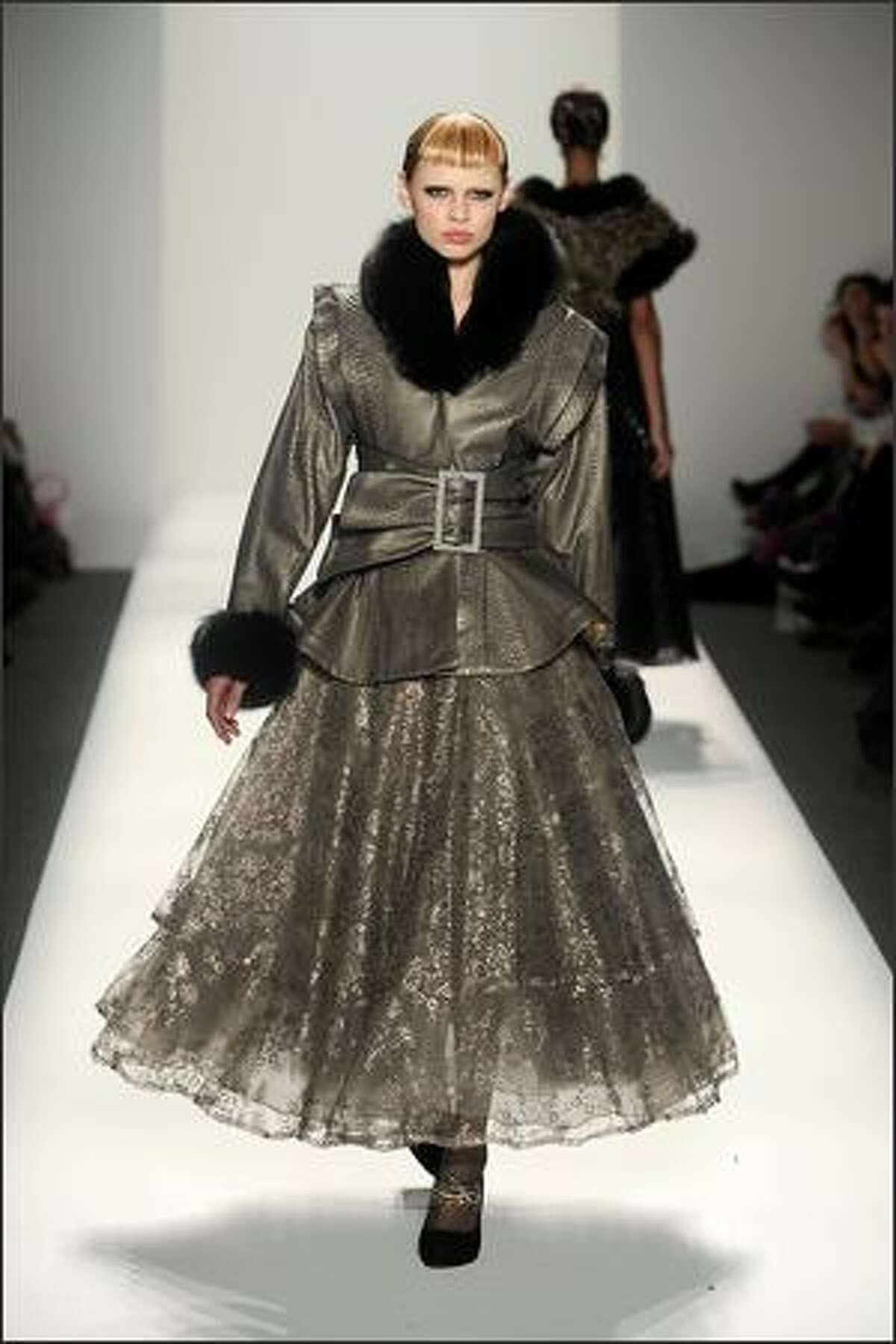 A model walks the runway at the Kati Stern/Venexiana fashion show.