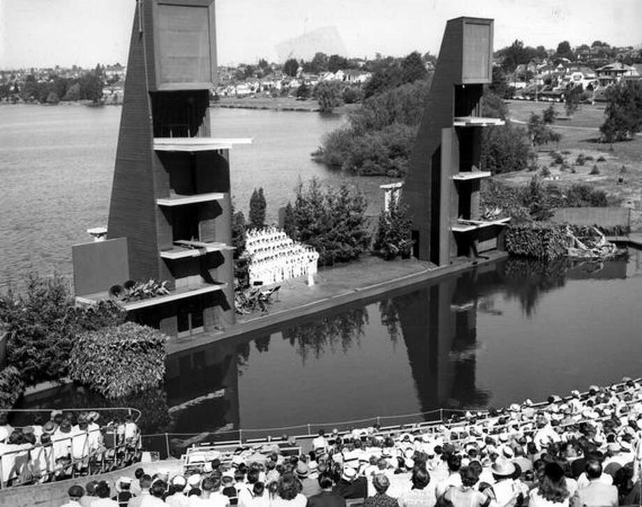 The Navy Cadet Choir sings between diving towers at the Green Lake Aqua Theater in August 1954. The theater was built in 1950 for the first Seafair. The Small Craft center now has the Green Lake site. Photo: P-I File
