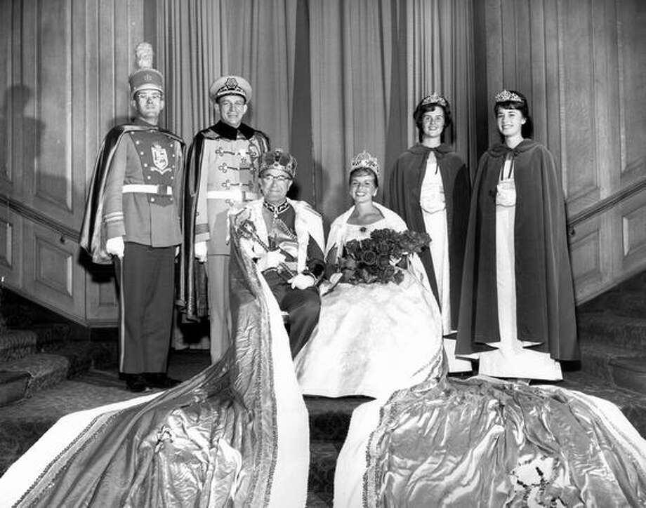 King Neptune, Cecil H. McKinstry, and Seafair Queen Patricia Reid, pose with members of the 1962 Seafair royalty. From left is Curt Tenzler, captain of the king's guard, Donald B. Craft, prime minister, and ladies in waiting Sheryl Coburn and Terry Jean Anderson. Photo: P-I File