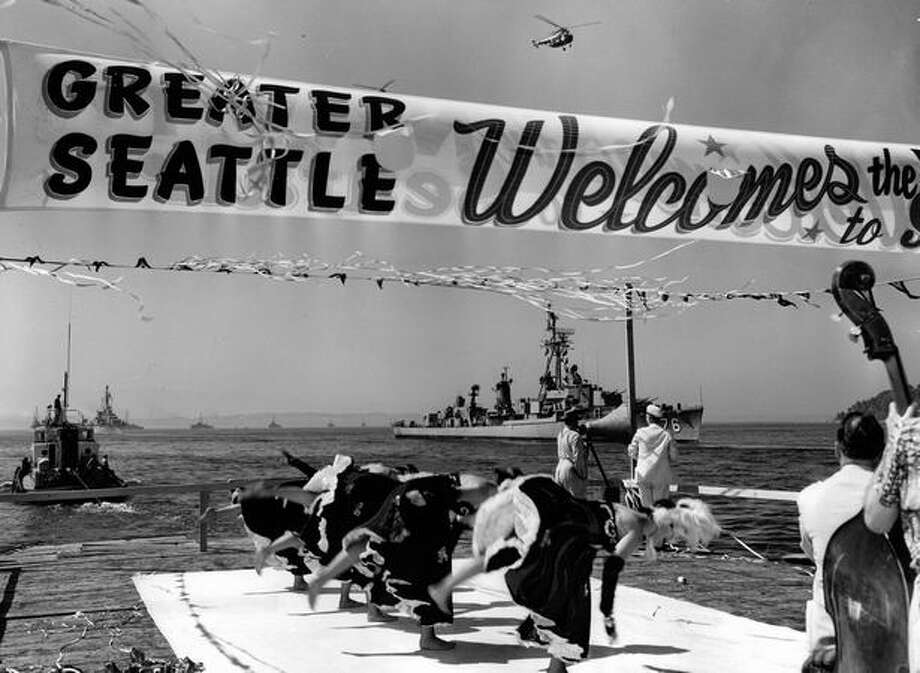 The Barclay Girls do a traditional can-can routine for a Naval armada in Elliott Bay, summer 1954. Photo: P-I File