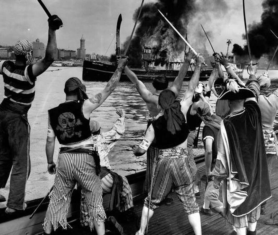 Seafair Pirates burn two of King Neptune's boats, a 136 former Navy ship and a 100-foot fishing tug to mark the end of the 1953 festival. Photo: P-I File