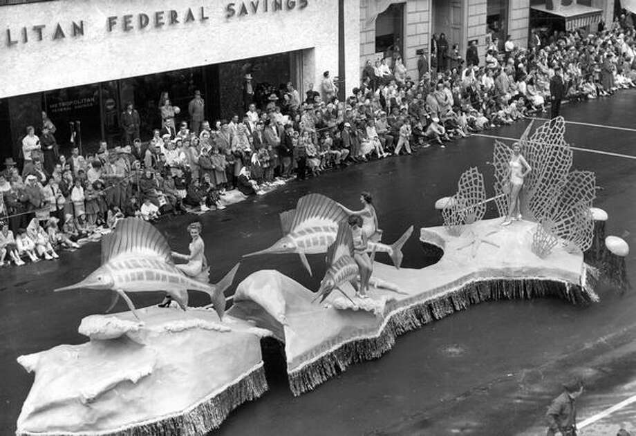 Four young women on the Standard Oil Co.'s float in the 1955 Torchlight Parade. Photo: P-I File