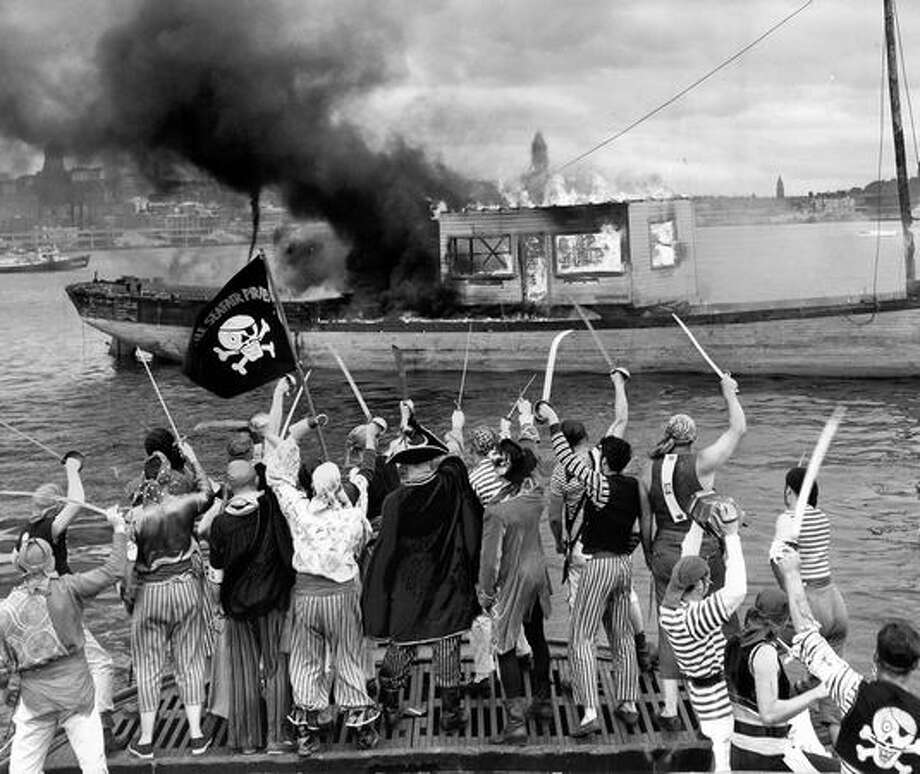 Seafair Pirates destroy an 1870s sailing ship, Gedney, in Elliott Bay to mark the end of Seafair, 1955. Photo: P-I File