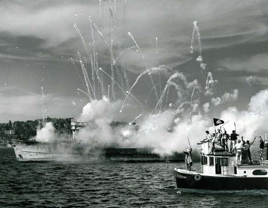 Seafair Pirates watch an old 153-foot Navy boat burn in Elliott Bay, 1953. Photo: P-I File