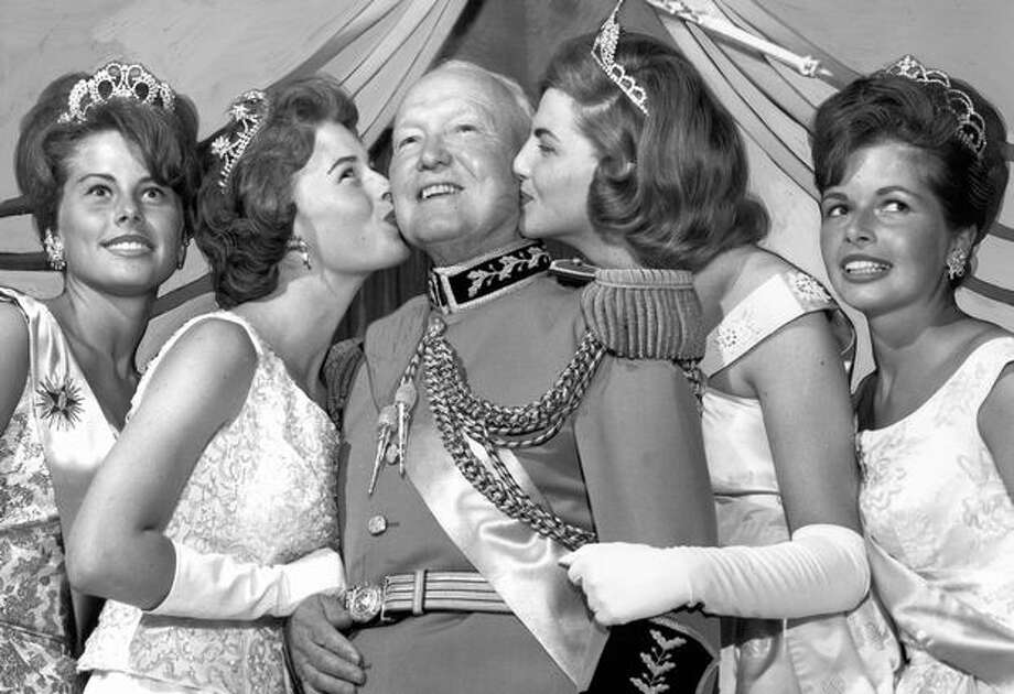 King Neptune, Vice. Adm. Albert M. Bledsoe with four Seafair queens in August 1964. They are, from left, Linda Juel, Sandra Teslow, Midge Erickson and Gail Reid. Photo: P-I File