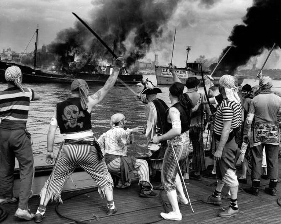 The Seafair pirates burn a boat in Elliott Bay, August 1954. Photo: P-I File