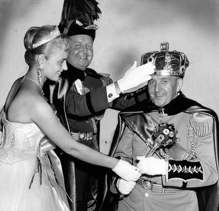 King Neptune X, Joseph E. Gandy, right, rises after the crown is placed on his head by outgoing King Neptune IX, W. Price Sullivan. Seafair Queen Judy Paulson is handing the scepter. The July 1959 ceremony was done at the Green Lake Aqua Theater, which is now the site of the Small Craft Center. Photo: P-I File