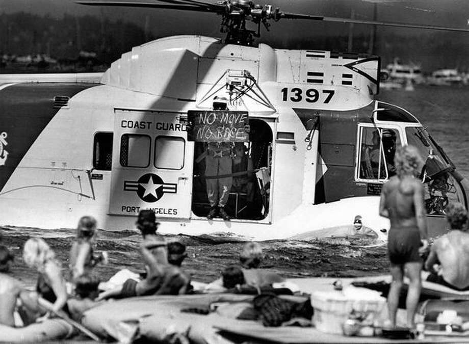 A Coast Guard helicopter warned hydroplane spectators they were too close to the boat races in August 1980. Races were delayed an hour while crowds were moved back. (Grant M. Haller/Seattlepi.com file) Photo: P-I File