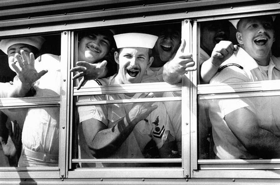A busload of sailors from the USS Enterprise gets ready to hit the town after landing at Terminal 30